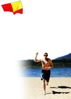 Man flying kite on the beach