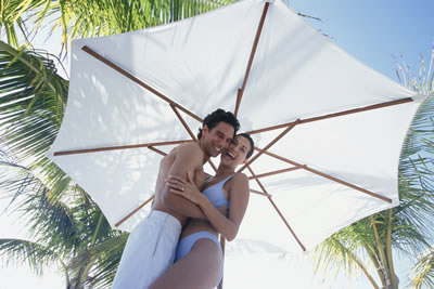 couple under beach umbrella