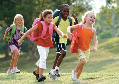 Diverse children walking to school.