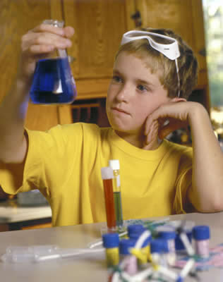 Boy doing science experiment