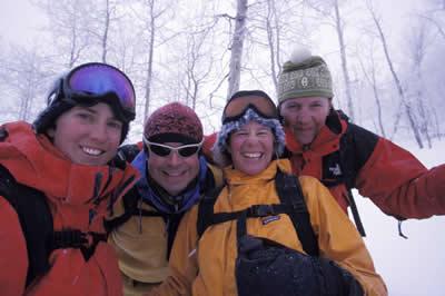 Skiers, riders enjoying snow